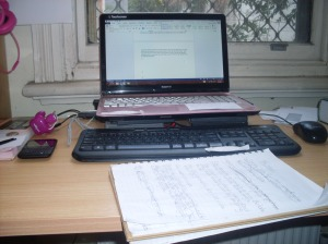 My work desk. You can see that I have 2 keyboards because I spilt soup on my laptop one.